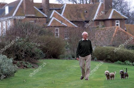 Lord Peter Carrington taking the dogs, Arthur and Harold for a walk