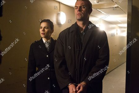 Hayley Atwell as Denise Woods and Julian Lewis Jones as Mike Holland.