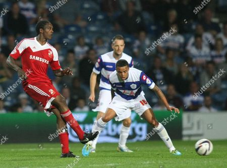 Swindon Town's Nile Ranger and Queens Park Rangers' Jermaine Jenas in action during todays match