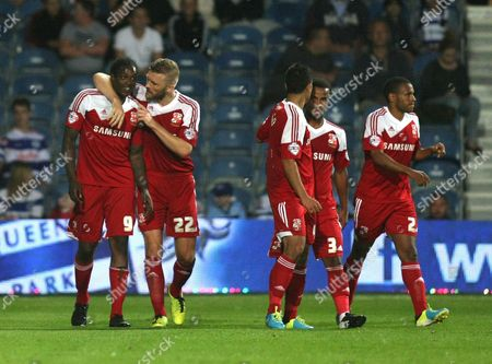 Swindon Town's Nile Ranger celebrates scoring the opening goal with team-mate Swindon Town's Darren Ward