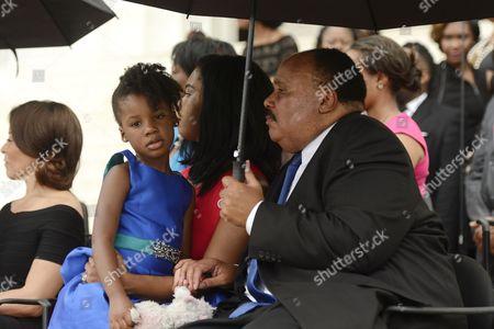 Yolanda Renee King, Arndrea Waters King and Martin Luther King III