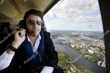 Justin Ross Lee in a helicopter