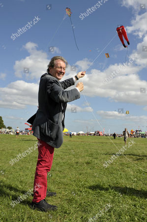 The Mayor of Bristol, George Ferguson, flys a kite in the shape of his trademark red trousers at The Bristol International Kite Festival
