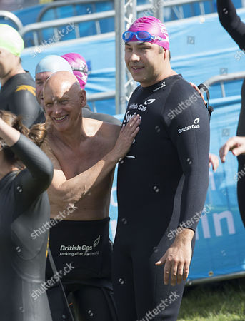 David Walliams warms up before his swim with Duncan Goodhew.