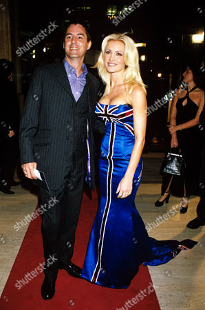 Stock Photo of Neil Morrissey and Caprice Bourret