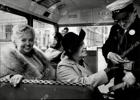 Jessie Matthews Obe (11 March 1907 Oo 19 August 1981) Was An English Actress Dancer And Singer Of The 1920s And 1930s Whose Career Continued Into The Post-war Period. Pictured On Left With Doris Hare Receiving Vintage Bus Ticket From Conductor Harry Barber On 1930's Bus.