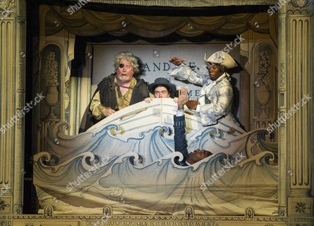 Ian Redford as Pangloss, Ciaran Owens as Sailor, Kevin Harvey as Jacques, Dwane Walcott as Candide-the Actor