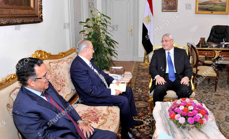Cyprus Foreign Affairs Minister Ioannis Kasoulides (centre) meets with Egyptian Interim President Adly Mansour (rt) and Egyptian Foreign Affairs Minister Nabil Fahmy (lt)