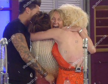 Carol McGiffin returns to the house and is welcomed by Mario Falcone, Vicky Entwistle and Lauren Harries