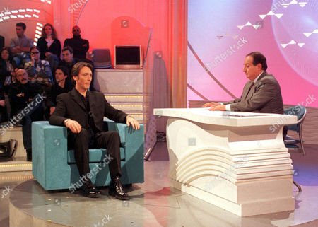 DANIEL DUCRUET BEING INTERVIEWED BY TV PRESENTER GIANCARLO MAGALLI