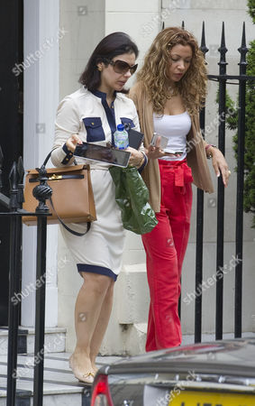 Picture Shows Nur Nadir (sunglasses) Leaving Home In London W1 Today. Wife Of Jailed Businessman Asil Nadir.