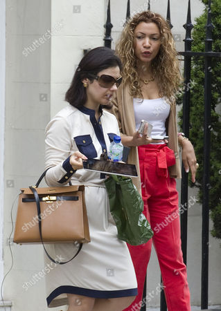 Stock Photo of Picture Shows Nur Nadir (sunglasses) Leaving Home In London W1 Today. Wife Of Jailed Businessman Asil Nadir.