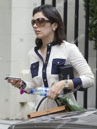Stock Picture of Picture Shows Nur Nadir (sunglasses) Leaving Home In London W1 Today. Wife Of Jailed Businessman Asil Nadir.