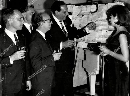 Stock Photo of Bandleader Edmundo Ros At A Party At The Savoy With Members Of His Band Trevor Lannion Syd Harris Bill Woiwod And Buzz Trueman And Linda Fryer.