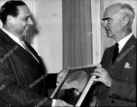 Band Leader Edmundo Ros Receives A Golden Disc From Sir Edward Lewis The Chairman Of Decca Records.