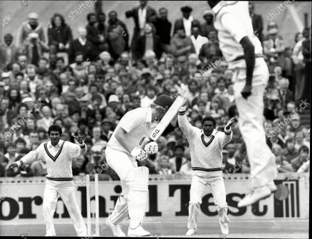 Cricket: West Indies Tour Of England 1980 - England V West Indies Third Cornhill Test At Old Trafford - Graham Dilley Is Bowled By Joel Garner.