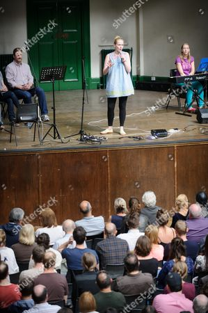 Atheist Church congregation and Leader Pippa Evans in charge of the service