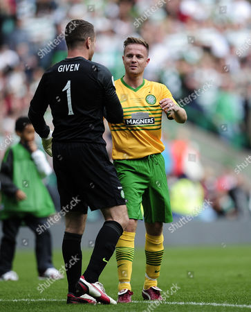 Shay Given and Nicky Byrne of Westlife at the end of the game.