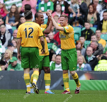 Westlife's Nicky Byrne celebrates scoring a goal with Gabriel Agbonlahor.