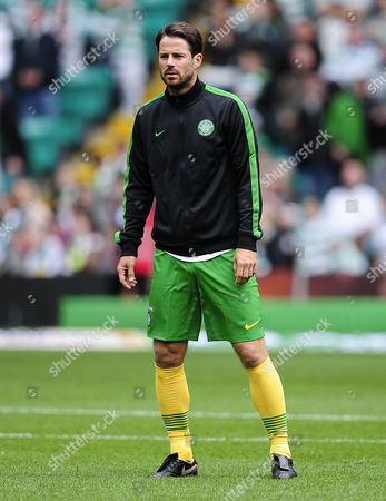 Former footballer and Sky Sports pundit Jamie Redknapp warms up prior to kick-off before competing in a charity football match
