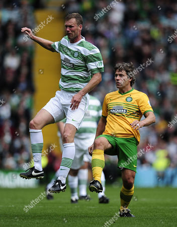 Comedian John Bishop challenges former Celtic player Morten Wieghorst whilst competing in a charity football match