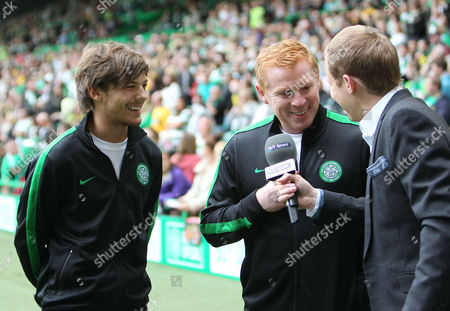 One Directions Louis Tomlinson and Celtic Manager Neil Lennon are interviewed before competing in a charity football match