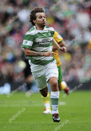 One Directions Louis Tomlinson with 1D in action running for the ball whilst competing in a charity football match