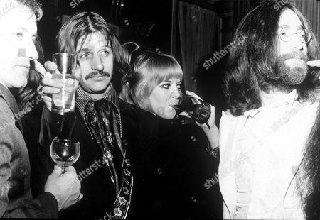 Stock Photo of Joseph McGrath, Ringo Starr, Maureen Cox Starkey and John Lennon at the premiere of the Film 'the Magic Christian', London, Britain - Dec 1969