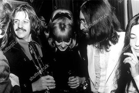 Stock Picture of  Ringo Starr, Maureen Cox Starkey and John Lennon at the premiere of the Film 'the Magic Christian', London, Britain - Dec 1969