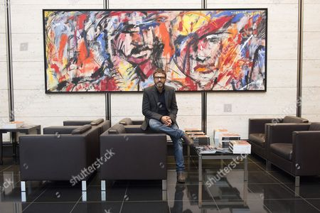Stock Photo of Dario Ballantini with his oil painting titled Identita Artefatte