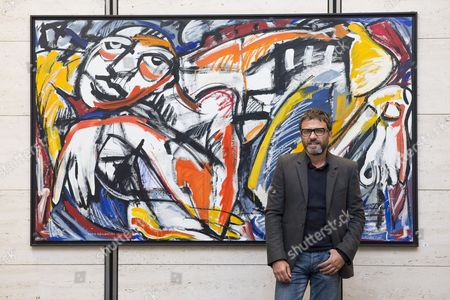 Stock Image of Dario Ballantini with his oil painting titled Qui Sotto