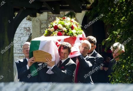 The coffin is taken from the church following the service