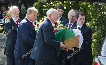 The coffin is taken from the church following the service.