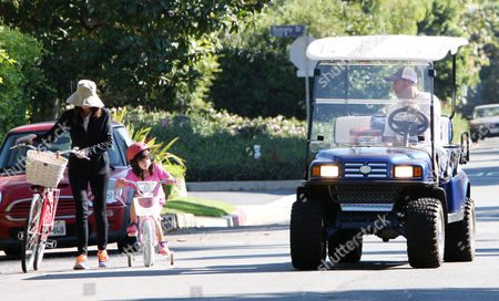 Editorial picture of Adam Sandler watches his daughter ride her new bicycle, Los Angeles, America - 15 Sep 2013