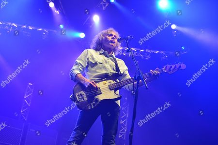 London, Britain - Bassist Alan Lancaster Of English Rock Group Status Quo Performing Live On Stage At Wembley Arena In London On March 17