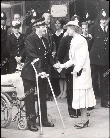 Princess Alexandra Unveiled A Memorial To The Police Officers Killed In The Harrods Bomb Blast And Then With A Gentle Touch Of The Hand Comforted A Constable Who Laid A Wreath For His Colleagues. Pc Jon Gordon Lost His Legs In The Explosion Which Also Killed His Dog Queenie But Was Able To Pull Himself From His Wheelchair And Limp Over To The Blue Pearl Granite Stone Close To The Knightsbridge Store. Someone Else Had To Carry The Flowers For Him.