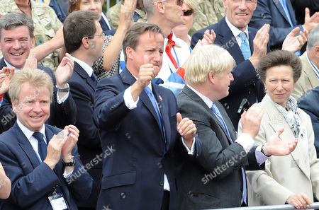 Editorial image of London Olympic Games 2012 Parade: An Emotional Prime Minister David Cameron (2nd Left With From Left To Right) Lord Moynihan Boris Johnson And Princess Anne The Princess Royal On The The Mall. In London Uk 10/09/2012. Picture Murray Sanders Daily Mai