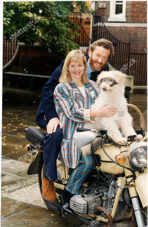 Editorial image of Liza Goddard Actress On Motorbike Pictured With Her Third Husband David Cobham And Dog Together For Children's Television Programme Woof! Goddard Stars In The Show Which Is Directed By Cobham 1993.