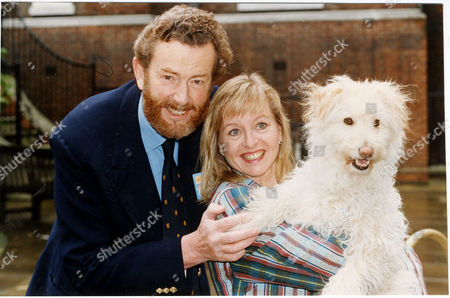 Stock Image of Liza Goddard Actress Pictured With Her Third Husband David Cobham And Dog Together For Children's Television Programme Woof! Goddard Stars In The Show Which Is Directed By Cobham 1993.