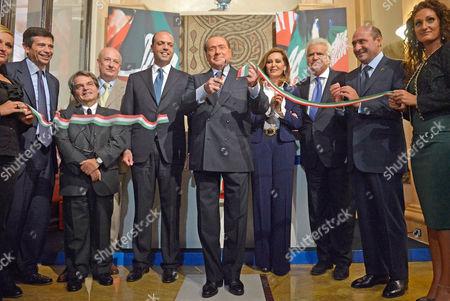 Silvio Berlusconi cutting the inaugural ribbon with Maurizio Lupi, Renato Brunetta, Sandro Bondi, Angelino Alfano, Daniela Santanche, Denis Verdini, and Rocco Crimi