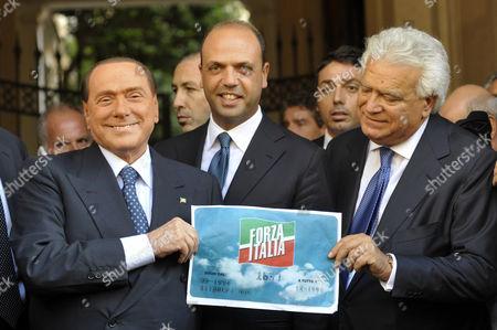 Silvio Berlusconi, Angelino Alfano and Denis Verdini with the logo of Forza Italia