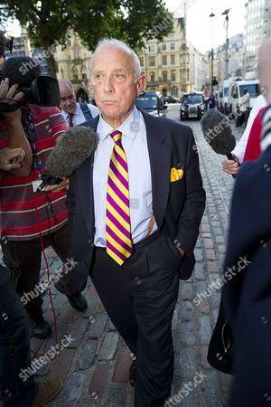 Godfrey Bloom being questioned by reporters as he leaves the 2013 UK Independence Party (UKIP) Annual Conference