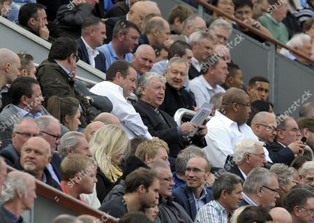Owner Mike Ashley and Director of Football Joe Kinnear sit together in the directors box