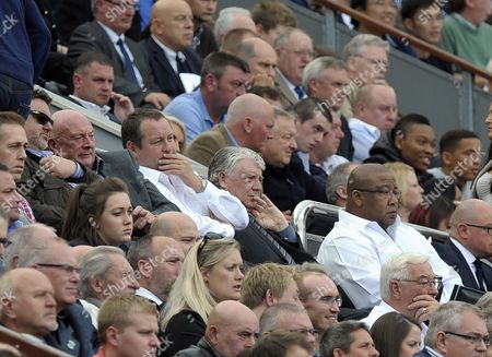 Owner Mike Ashley and Director of Football Joe Kinnear watch the game in the directors box