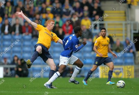 Stock Picture of Chesterfield's Tendayi Darikwa and Oxford United's Dave Kitson in action during todays match