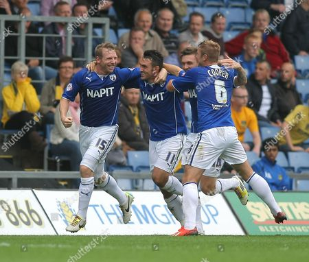Chesterfield's Ritchie Humphreys celebrates scoring the opening goal with team-mates