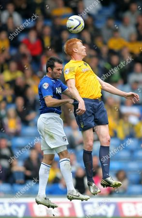 Oxford United's Dave Kitson battles with Chesterfield's Sam Hird