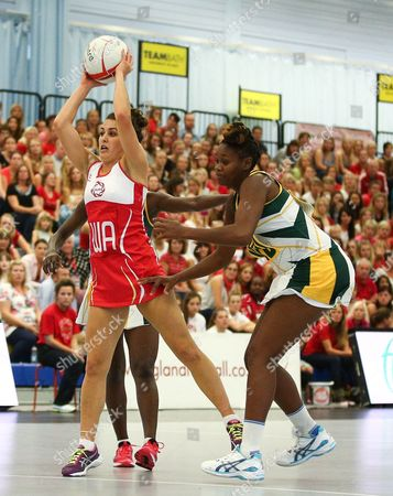 Mia Ritchie of England Netball and Nokuthula Qegu of South Africa in action