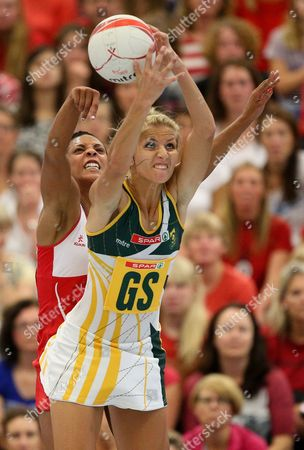 Stacey Francis of England Netball tries to block Melissa Myburgh of South Africa