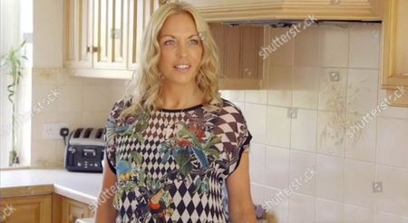 Stock Image of Sheryl Gascoigne in her kitchen at home